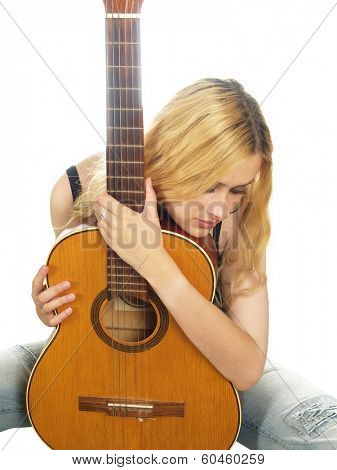 portrait of young woman with guitar over white