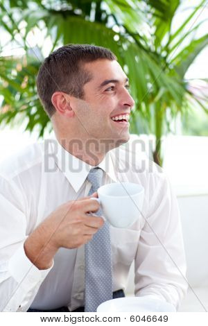 Businessman Relaxing With A Cup Of Coffee