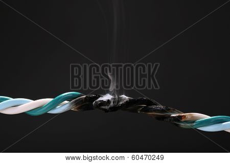 Short circuit, burnt cable, isolated on black