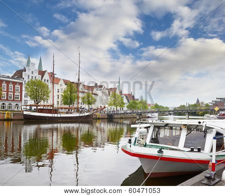 Lubeck On The Upper Trave River With Old Facades Ans Boats