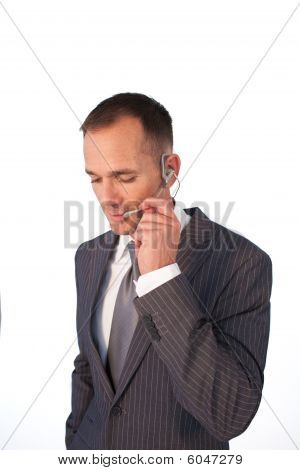 Businessman With A Headset On Talking