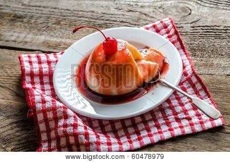 Panna Cotta With Berry Sauce And Maraschino Cherry