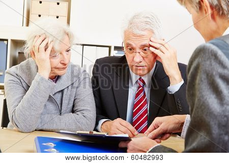 Anxious elderly senior couple worring about financial security at consultation