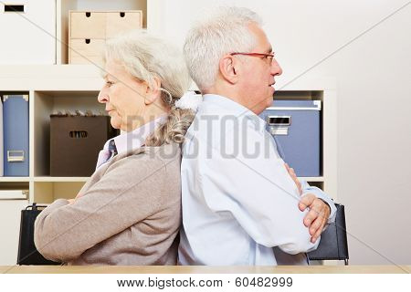 Angry senior couple having a silent fight at home