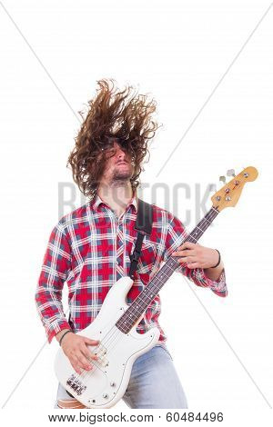 Man In Red Shirt With Tousled Hair Playing Electric Bass Guitar