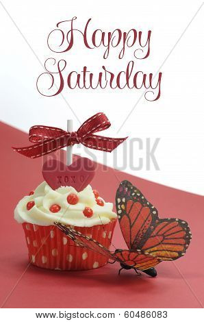 Red Theme Cupcake With Butterfly On Red And White Background With Happy Saturday Sample Text Or Copy