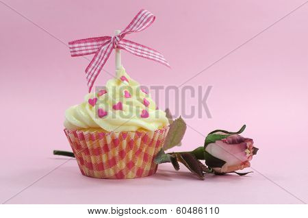 Pretty Pink Cupcake With Pale Pink Silk Rose Bud On Pink Background For Female Birdthay, Wedding, Va