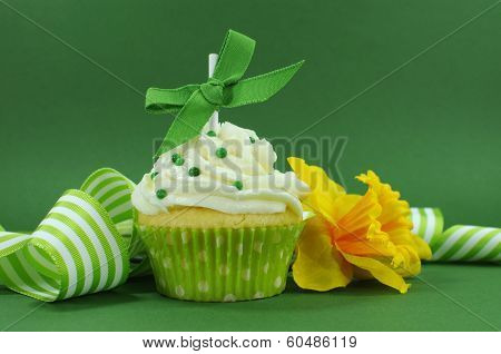 Beautiful Green Decorated Cupcake With Daffodil And Stripe Ribbon On Green Background For Spring, St