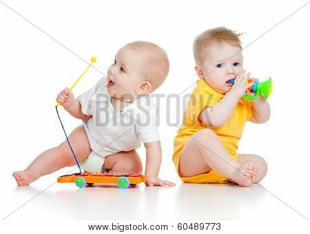 Funny Boys Babies  With Musical Toys. Isolated On White Background