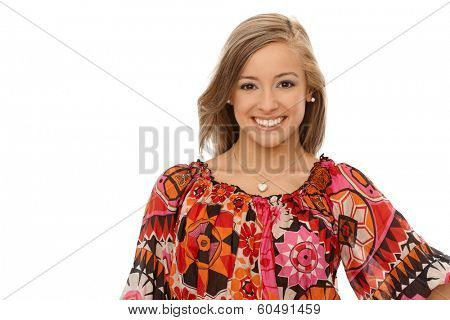 Portrait of happy blonde woman in colorful blouse.