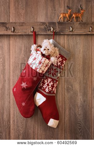 Two Christmas stockings with teddy bear and snowman gifts