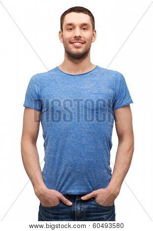 t-shirt design concept - smiling man in blank blue t-shirt