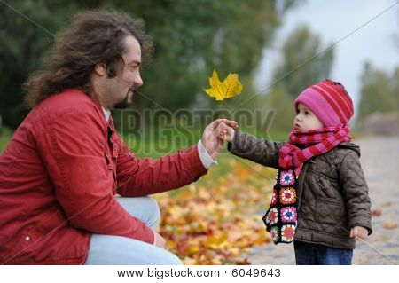 Father And His Baby Girl In An Autumn Park