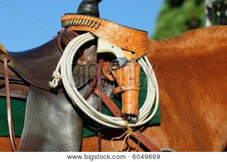 Saddle, Rope And Gun