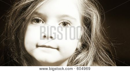 Blond Girl Face In Sepia
