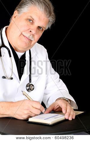 Handsome Mature Medical Doctor Writing A Script