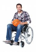 foto of paralympics  - Man in wheelchair with basketball - JPG