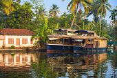 picture of houseboats  - reflection houseboat and house in kerala backwaters India - JPG