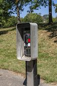 stock photo of phone-booth  - Public phone booth in a park in Washington DC - JPG