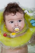 pic of lifeline  - Baby bathes in a bathroom with a lifeline - JPG