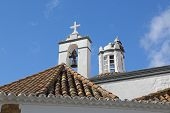 Top View of a church with stork birds in nest - Faro, Algarve, Portugal
