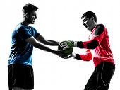 two caucasian soccer player goalkeeper men competition in silhouette isolated white background