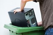 stock photo of informatics  - Men throwaway hardware into a plastic container - JPG