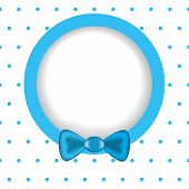 Round Frame With Polka Dot Effect Paper With A Blue Ribbon.