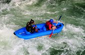 stock photo of rafters  - Two rafters navigate the class 3 rapids of Rio Pejibaye - JPG