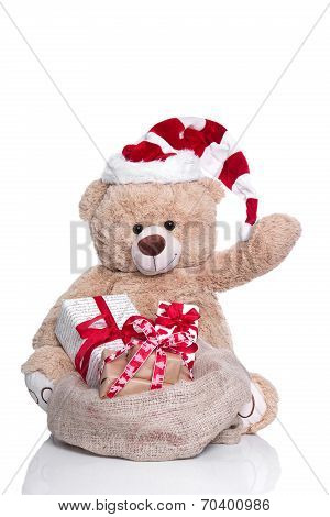 Cuddly Teddy Bear Waving ,wearing Christmas Hat And Gift Boxes On White Background
