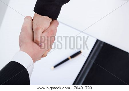 Close-up Of A Businessmen Shaking Hands