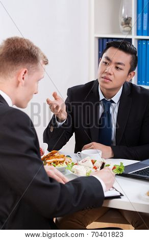 Co-workers Talking During Lunch