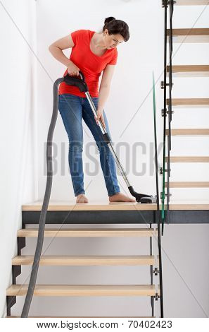 Young Housekeeper During Hoovering