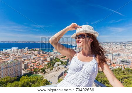 Pretty Girl In A Hat And Sunglasses Posing Against The City Of