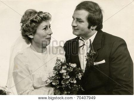 SIERADZ, POLAND, OCTOBER 26, 1985 - vintage photo of newlyweds