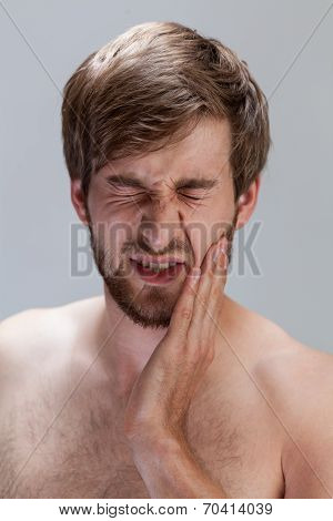 Man Suffering From Toothache