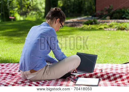 Lady Working On Computer In Garden