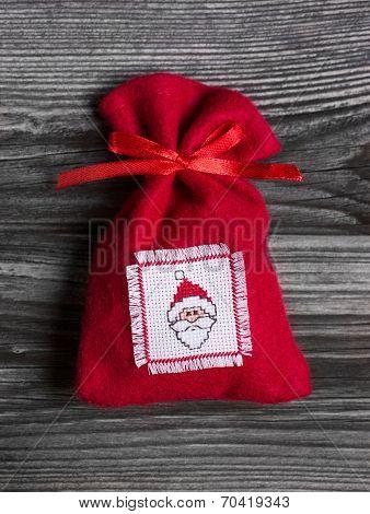 Handmade Red Christmas Sac With A Embroided Santa Hat On Felt.