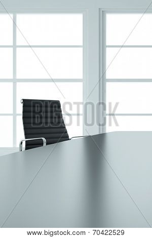 Empty office chair and table in business boardroom