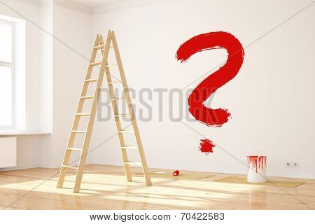 Big red question mark on wall in interior room while renovating