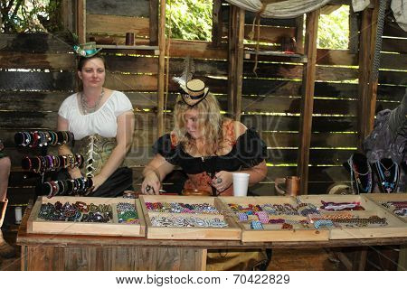 MUSKOGEE, OK - MAY 24: Woman dressed in vintage clothes makes jewelry at the Oklahoma 19th annual Renaissance Festival on May 24, 2014 at the Castle of Muskogee in Muskogee, OK