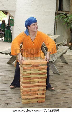 MUSKOGEE, OK - MAY 24: A man demonstrates his skills at an old game at the Oklahoma 19th annual Renaissance Festival on May 24, 2014 at the Castle of Muskogee in Muskogee, OK