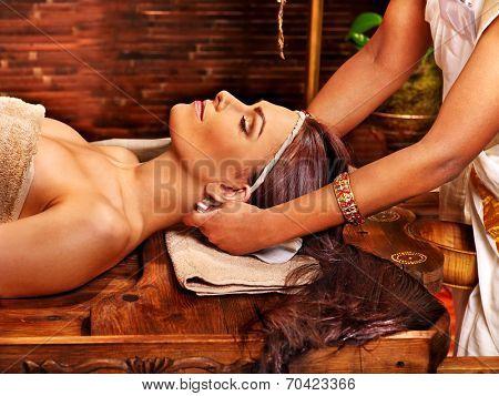 Woman having facial  ayurveda spa treatment.