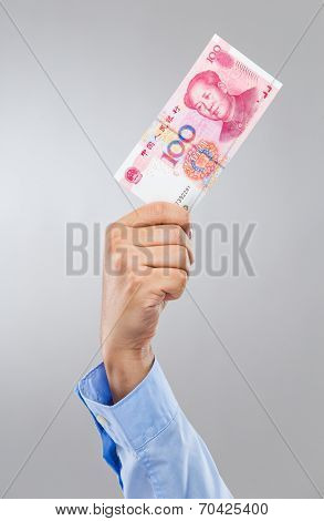Businessman hand hold hundred chinese renminbi