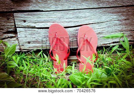 Leaning Red Flip-flops