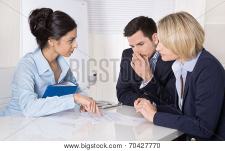 Group Of A Professional Business Team Sitting At The Table Talking Together.