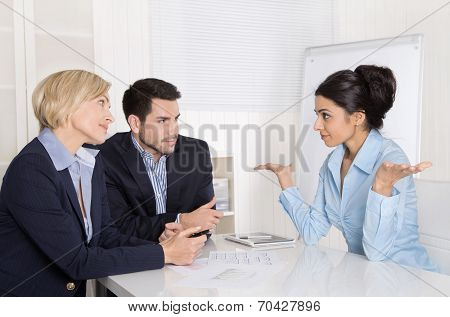 Job Interview Or Business Meeting: Man And Woman Sitting At The Table In The Office Talking Together