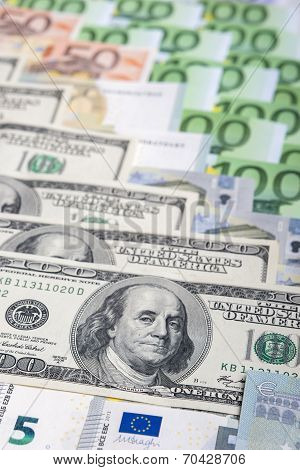 World Currency Concept: Closeup Of European And The Us Hard Currencies Together