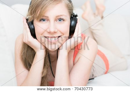 Time to relaxing, attractive young teenager girl listening to music