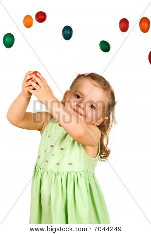 Little Girl Catching The Easter Eggs